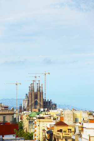 gaudi: BARCELONA, SPAIN - AUGUST 14, 2011: View to Sagrada Familia under construction in Barcelona in Spain. It is called in English as Basilica and Expiatory Church of Holy Family. It was designed by Antoni Gaudi Editorial