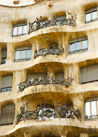 gaudi: BARCELONA, SPAIN - AUGUST 14, 2011: Balcony of Casa Mila in Barcelona in Spain. Also called as La Pedrera. In English it is called as Miracle Home, or The Quarry. It was designed by Antoni Gaudi, Spanish artist