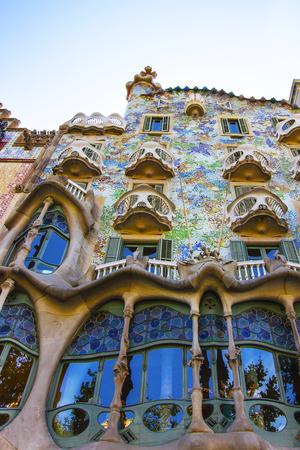 gaudi: BARCELONA, SPAIN - AUGUST 14, 2011: Casa Batllo building in Barcelona in Spain. It is also called as House of Bones. It was designed by Antoni Gaudi