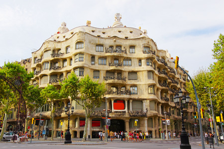 spanish home: BARCELONA, SPAIN - AUGUST 14, 2011: Casa Mila in Barcelona in Spain. Also called as La Pedrera. In English it is called as Miracle Home, or The Quarry. It was designed by Antoni Gaudi, Spanish artist