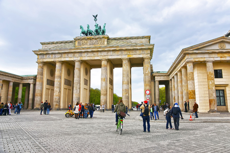 gate: Brandenburg Gate in Berlin in Germany. The Brandenburg Gate is a triumphal arch, a city gate in the center of Berlin. It is one of the most known sites in Berlin. Editorial