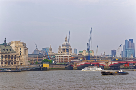 blackfriars bridge: St Paul Cathedral and Blackfriars Bridge on Northern Bank of River Thames in London, UK. Saint Paul Cathedral is Anglican church. Blackfriars Bridge is a  traffic and road bridge over Thames River Stock Photo