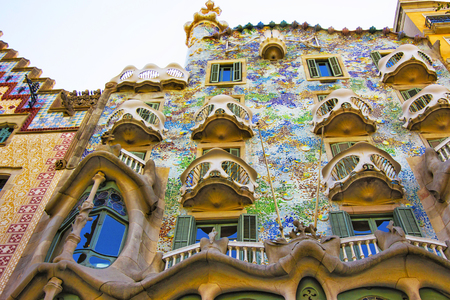 BARCELONA, SPAIN - AUGUST 14, 2011: Balconies of Casa Batllo building in Barcelona in Spain. It is also called as House of Bones. It was designed by Antoni Gaudi, Spanish architect. Imagens - 55062823