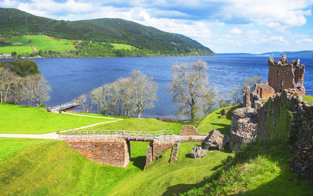 ness: Panoramic view to Ruins of Urquhart Castle in Loch Ness in Scotland. Loch Ness is a city in the Highlands in Scotland in the United Kingdom. Stock Photo