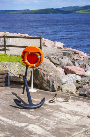 loch ness: Anchor on the Pier in Loch Ness in Scotland. Loch Ness is a city in the Highlands in Scotland in the United Kingdom. Stock Photo