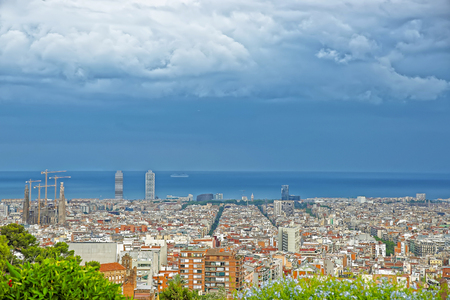 gaudi: Panoramic view to Sagrada Familia and the Mediterranean sea in Barcelona in Spain. It is called in English as Basilica and Expiatory Church of Holy Family. It was designed by Antoni Gaudi