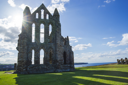 heritage protection: Whitby Abbey at sunset in North Yorkshire in England. It is ruins of the Benedictine abbey. Now it is under protection of the English Heritage.