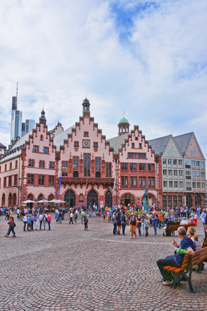rathaus: FRANKFURT, GERMANY - APRIL 29, 2012: Romer City Hall in Frankfurt in Germany. The Romerberg consists of old houses. Tourists nearby