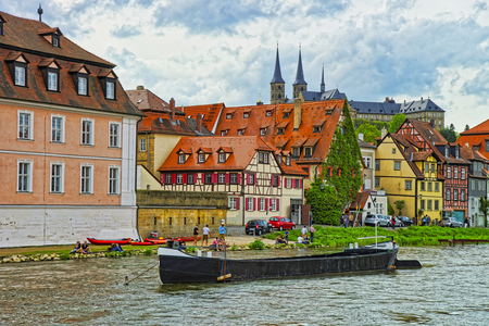 bayern old town: Panoramic view on Little Venice in Bamberg in Germany. It is a set of fisherman houses along river Regnitz. The city in under the UNESCO protection. People nearby