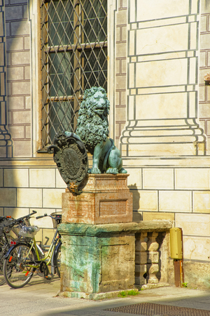 residenz: MUNICH, GERMANY - MAY 8, 2013: Lion statue near Munich Residence in Munich in Germany. The Munich Residenz used to be the royal palace. It is the largest palace in Germany.