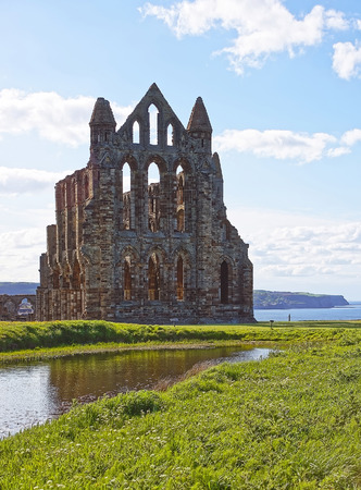abbey ruins abbey: Whitby Abbey and North Sea in North Yorkshire in England. It is ruins of the Benedictine abbey. Now it is under protection of the English Heritage.