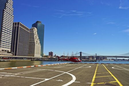 helicopter pad: Helicopter and helicopter pad in Lower Manhattan in New York, USA, on East River. Pier 6. Stock Photo