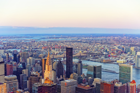 queensboro bridge: Panoramic view from Observatory deck of the Empire State Building on Midtown district of Manhattan in New York. East river and New York Queensboro Bridge in Long Island City are on the background.