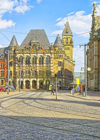 courthouse: Courthouse of Bremen in Germany. It is called Landgericht and placed on Domsheide square in the Old town of Bremen. It is made in the Renaissance style. People nearby