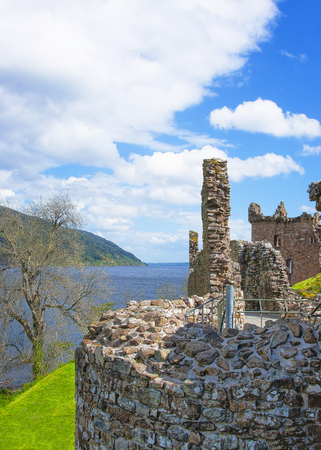 ness: Ruins of Urquhart Castle in Loch Ness in Scotland. Loch Ness is a city in the Highlands in Scotland in the United Kingdom.