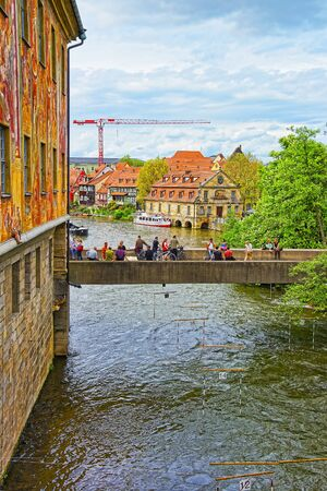 the little venice: BAMBERG, GERMANY - MAY 9, 2013: Old city hall and Bridge over Regnitz River in Bamberg in Germany. View to fisherman houses in Little Venice. People nearby