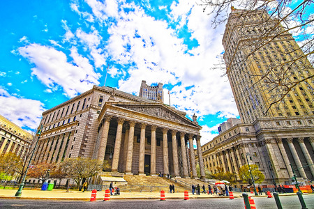 criminal case: Street view on Thurgood Marshall United States Courthhouse and New York State Supreme Building, or New York County Courthouse, in Lower Manhattan, New York, USA. Tourists nearby. Editorial
