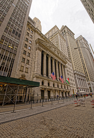 nyse: NEW YORK, USA - APRIL 24, 2015: New York Stock Exchange on Wall Street of Lower Manhattan, USA. It is called NYSE in short. Tourists nearby.