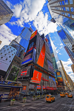 42nd: NEW YORK, USA - APRIL 24, 2015: Intersection of Broadway and West Street 42nd in Midtown Manhattan, New York, USA. It is Times Square. Tourists nearby