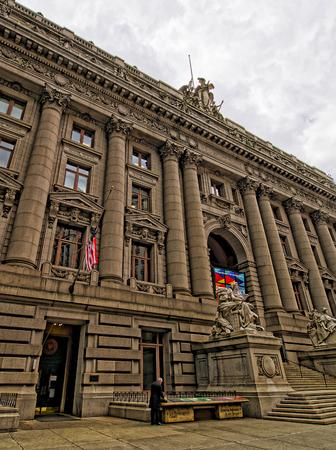 alexander hamilton: NEW YORK, USA - APRIL 24, 2015: Alexander Hamilton US Custom House, Lower Manhattan, New York, USA. Now it is the National Museum of American Indians. Tourist nearby