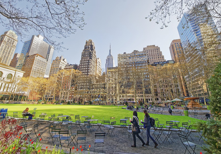 Tourists looking at Green Lawn and Skyscrapers in Bryant Park in Midtown Manhattan, New York, USA. Editorial