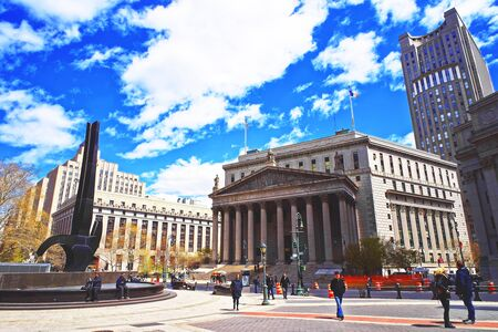 municipal court: New York, USA - April 24, 2015: Tourists in the street and New York State Supreme Building, or New York County Courthouse, in Lower Manhattan, New York, USA.