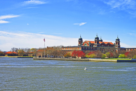 immigrant: Immigrants station in Ellis Island, USA, in Upper New York Bay. It was a gateway for immigrants who came to immigrant inspection. Editorial