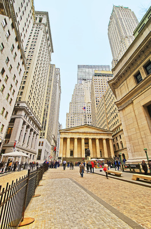 george washington statue: NEW YORK, USA - APRIL 24, 2015: Federal Hall and tourists in Wall Street in Lower Manhattan, New York City, USA. It was US Custom House. In front of the building there is George Washington Statue Editorial