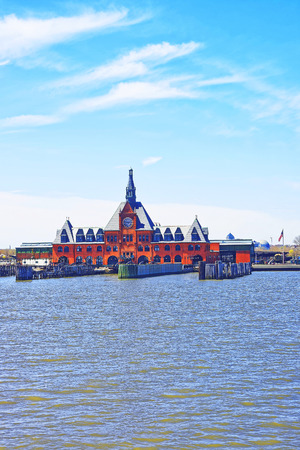 hudson: Central Railroad of New Jersey Terminal, USA, in Hudson Waterfront, Hudson River. Ferry slips serving boats.