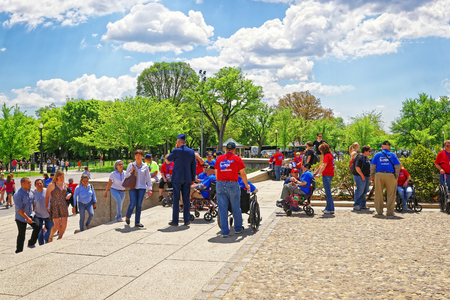 west end: Washington DC, USA - May 2, 2015: War Veterans and guardians of Honor Flight non-profit organization at the staircase near Lincoln Memorial, west end of National Mall.