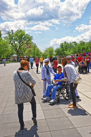 west end: Washington DC, USA - May 2, 2015: War Veterans, tourists and guardians of Honor Flight non-profit organization in the area near Lincoln Memorial, west end of National Mall. Editorial