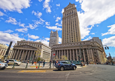 municipal court: New York, USA - April 24, 2015: Tourists in the street and New York State Supreme Building in spring time, or New York County Courthouse, in Lower Manhattan, New York, USA.
