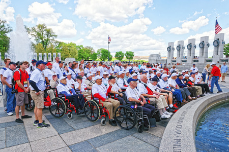 honour: Washington DC, USA - May 2, 2015: Tourists and group photo of War Veterans, members of Honor Flight Central Florida nonprofit organization, at Pillars on National World War 2 Memorial, National Mall.