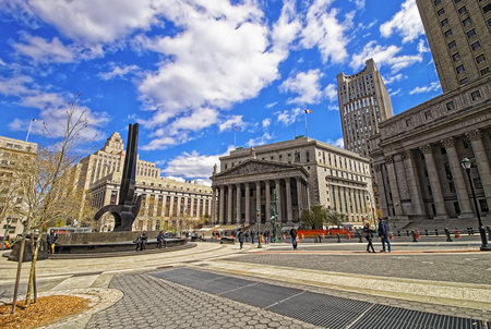 municipal court: New York, USA - April 24, 2015: Tourists in the street and New York State Supreme Building in spring, or New York County Courthouse, in Lower Manhattan, New York, USA.