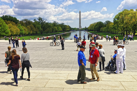 nonprofit: Washington DC, USA - May 2, 2015: War Veterans and guardians of Honor Flight of Middle Tenessee non-profit organization at Lincoln Memorial Reflecting Pool. Washington Monument on background