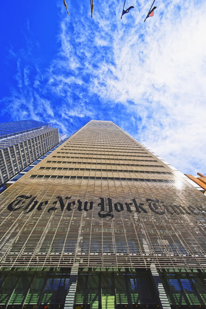 daily newspaper: New York, USA - April 25, 2015: The New York Times daily newspaper skyscraper in Midtown Manhattan in New York, USA. It is placed on 8th avenue.