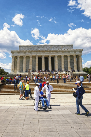 nonprofit: Washington DC, USA - May 2, 2015: War Veterans and guardians of Honor Flight non-profit organization at Lincoln Memorial, west end of National Mall.