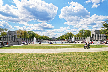 guardians: Washington DC, USA - May 2, 2015: War Veterans and guardians of Honor Flight nonprofit organization in National World War 2 Memorial, National Mall. Lincoln memorial in the middle on the background.