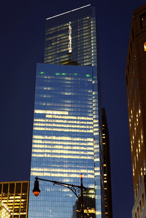 illuminate: April 24, 2015: One World Trade Center in Financial District, Lower Manhattan, New York City, USA, late in the evening. Street lights are reflected and illuminate the glass