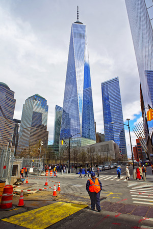 manhattan mirror new york: New York, USA - April 24, 2015: Road view on Freedom Tower and people in Financial District in Lower Manhattan, New York, USA Editorial
