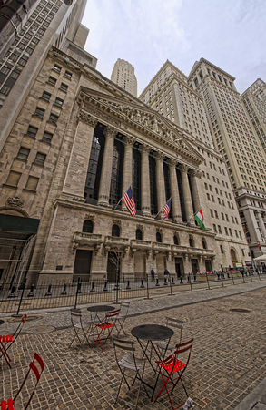 nyse: NEW YORK, USA - APRIL 24, 2015: Street view on New York Stock Exchange on Wall Street, Lower Manhattan, USA. It is called NYSE in short. Editorial