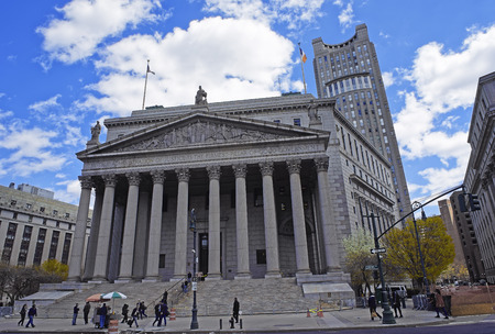 municipal court: NEW YORK, USA - APRIL 24, 2016: Street view on New York State Supreme Building, or New York County Courthouse, in Lower Manhattan, New York, USA. Tourists nearby. Editorial