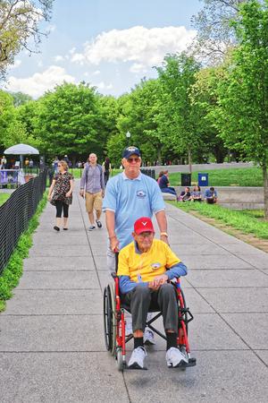 tallahassee: Washington DC, USA - May 2, 2015: Tourists and War Veteran and guardian of Honor Flight Tallahassee nonprofit organization in the National Mall.