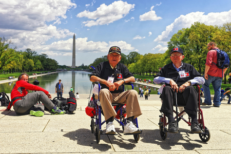 guardians: Washington DC, USA - May 2, 2015: War Veterans and guardians of Honor Flight of Middle Tenessee non-profit organization next to Lincoln Memorial Reflecting Pool. Washington Monument on the background.