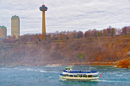 niagara river: Ferry in the Niagara River and Skyscrapers from the Canadian side. A view from American side. Tourists on board Editorial