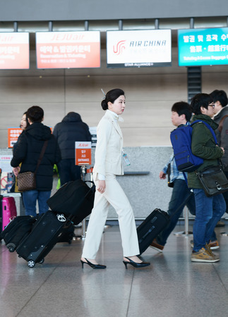 incheon: Incheon, South Korea - February 15, 2016: Asian Korean female flight attendant in the Incheon international airport. It is one of the largest and busiest world airports Editorial