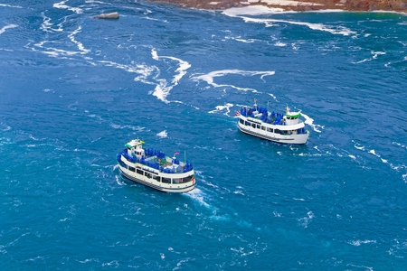 niagara river: Two Ferries in the Niagara River. A view from American side. Niagara River is a river from Lake Ontario to Lake Erie. It is a natural border between Canada and the USA. Tourists on board