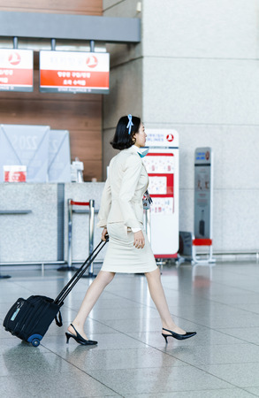 air hostess: Incheon, South Korea - February 15, 2016: Asian Korean female air flight attendant at International airport of Incheon. It is one of the largest and busiest world airports. Editorial