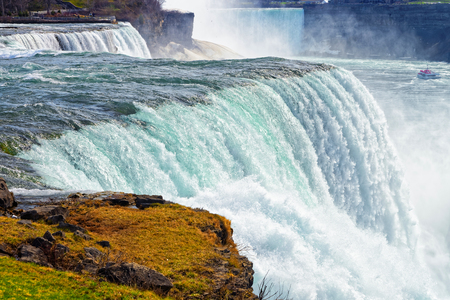 american falls: Niagara Falls ans a ship. A view from Niagara State Park on American Falls, Bridal Veil Falls, Goat Island and Horseshoe falls on the background.