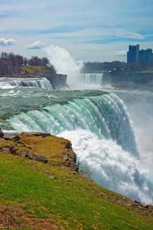 american falls: Niagara Falls of American side and Skyscrapers of Canadian side. A view on American Falls, Bridal Veil Falls, Goat Island, Horseshoe falls and Canada Skyscrapers on the background.